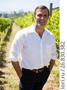 Купить «Portrait of smiling vintner standing with hands in pockets», фото № 26830382, снято 31 января 2017 г. (c) Wavebreak Media / Фотобанк Лори