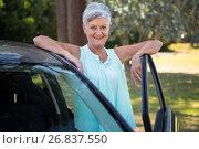 Купить «Senior woman standing beside a car», фото № 26837550, снято 3 февраля 2017 г. (c) Wavebreak Media / Фотобанк Лори