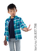 Купить «Boy pretending to hold invisible object», фото № 26837798, снято 24 января 2017 г. (c) Wavebreak Media / Фотобанк Лори