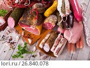 Купить «Variety of meats on table», фото № 26840078, снято 18 октября 2018 г. (c) Яков Филимонов / Фотобанк Лори