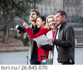 Купить «Portrait of tourists with map and baggage seeing the sights in European city», фото № 26845070, снято 19 октября 2018 г. (c) Яков Филимонов / Фотобанк Лори