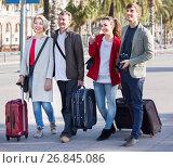 Купить «Two couples with baggage sightseeing and smiling», фото № 26845086, снято 19 октября 2018 г. (c) Яков Филимонов / Фотобанк Лори