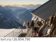 Купить «Chamonix, France - DEC 30, 2016: Tourists are resting at hut on the top of Grands Montets in French Alps», фото № 26854790, снято 30 декабря 2016 г. (c) Юлия Кузнецова / Фотобанк Лори