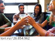 Купить «happy friends drinking beer at bar or pub», фото № 26854962, снято 14 июля 2016 г. (c) Syda Productions / Фотобанк Лори