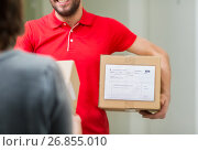 Купить «happy delivery man with parcel box and customer», фото № 26855010, снято 3 декабря 2016 г. (c) Syda Productions / Фотобанк Лори