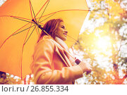 happy woman with umbrella walking in autumn park. Стоковое фото, фотограф Syda Productions / Фотобанк Лори