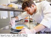 Купить «male chef cooking food at restaurant kitchen», фото № 26855562, снято 2 апреля 2017 г. (c) Syda Productions / Фотобанк Лори