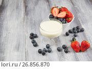 Strawberry, blueberry with yogurt on a gray wooden background. Стоковое фото, фотограф Алексей Спирин / Фотобанк Лори