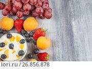 Strawberries, blueberries, apricot with yoghurt on a wooden board. Стоковое фото, фотограф Алексей Спирин / Фотобанк Лори