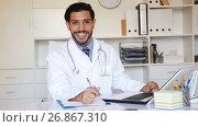 Купить «Spanish man doctor is working with documents behind laptop in his office.», видеоролик № 26867310, снято 9 августа 2017 г. (c) Яков Филимонов / Фотобанк Лори