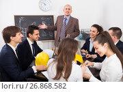 Купить «Team of engineers discussing business project», фото № 26868582, снято 7 декабря 2019 г. (c) Яков Филимонов / Фотобанк Лори