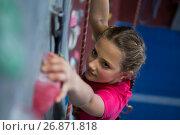 Купить «Determined teenage girl practicing rock climbing», фото № 26871818, снято 10 мая 2017 г. (c) Wavebreak Media / Фотобанк Лори