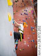 Купить «Determined boy practicing rock climbing», фото № 26872202, снято 10 мая 2017 г. (c) Wavebreak Media / Фотобанк Лори