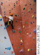 Купить «Determined boy practicing rock climbing», фото № 26873362, снято 10 мая 2017 г. (c) Wavebreak Media / Фотобанк Лори