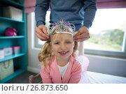 Купить «Father putting a tiera on daughters head», фото № 26873650, снято 25 мая 2017 г. (c) Wavebreak Media / Фотобанк Лори