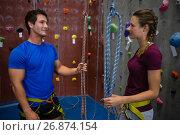 Купить «Trainer training female athlete in climbing wall at club», фото № 26874154, снято 10 мая 2017 г. (c) Wavebreak Media / Фотобанк Лори