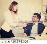 Купить «Business couple flirting in office», фото № 26874666, снято 1 июня 2017 г. (c) Яков Филимонов / Фотобанк Лори