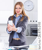 Купить «Business woman using phone», фото № 26875010, снято 20 апреля 2017 г. (c) Яков Филимонов / Фотобанк Лори