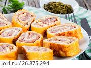 Купить «Baked cheese meat Roll-Ups on white dish, close-up», фото № 26875294, снято 21 ноября 2019 г. (c) Oksana Zh / Фотобанк Лори