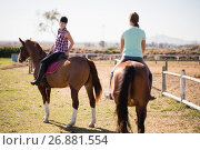 Купить «Female friends horseback riding on field», фото № 26881554, снято 3 мая 2017 г. (c) Wavebreak Media / Фотобанк Лори