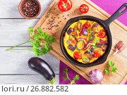 Купить «frittata with red onion, eggplant, tomato, top view», фото № 26882582, снято 16 августа 2016 г. (c) Oksana Zh / Фотобанк Лори