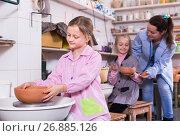 Купить «teacher helping teenagers at making pottery during arts and crafts class», фото № 26885126, снято 28 января 2020 г. (c) Яков Филимонов / Фотобанк Лори