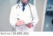 Купить «close up of doctor with clipboard at hospital», фото № 26885262, снято 3 декабря 2015 г. (c) Syda Productions / Фотобанк Лори