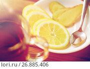 Купить «tea cup with lemon and ginger on plate», фото № 26885406, снято 13 октября 2016 г. (c) Syda Productions / Фотобанк Лори