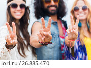 Купить «happy young hippie friends showing peace outdoors», фото № 26885470, снято 27 августа 2015 г. (c) Syda Productions / Фотобанк Лори