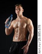 Купить «young man or bodybuilder with bottle of water», фото № 26885678, снято 2 июля 2017 г. (c) Syda Productions / Фотобанк Лори