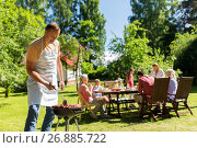 Купить «man cooking meat on barbecue grill at summer party», фото № 26885722, снято 9 июля 2017 г. (c) Syda Productions / Фотобанк Лори