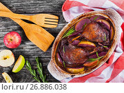 Купить «two roasted duck legs grilled in red wine and apple», фото № 26886038, снято 10 октября 2016 г. (c) Oksana Zhupanova / Фотобанк Лори