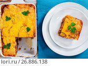 Купить «portion of delicious moussaka decorated with parsley», фото № 26886138, снято 26 октября 2016 г. (c) Oksana Zh / Фотобанк Лори