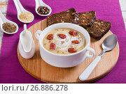Купить «Beer and Cheddar cream Soup with Kielbasa Sausage», фото № 26886278, снято 16 января 2019 г. (c) Oksana Zh / Фотобанк Лори