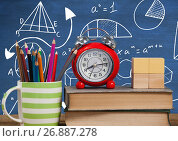 Купить «Objects on Desk foreground with blackboard graphics of math equations», фото № 26887278, снято 18 февраля 2019 г. (c) Wavebreak Media / Фотобанк Лори