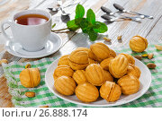 Купить «Walnuts Shape Sweet Homemade Cookies with sweet condensed milk filling», фото № 26888174, снято 21 ноября 2018 г. (c) Oksana Zh / Фотобанк Лори