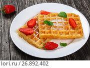 Купить «Belgian waffles with strawberries», фото № 26892402, снято 22 октября 2019 г. (c) Oksana Zh / Фотобанк Лори