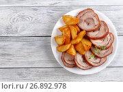Купить «turkey roulade with fried potato wedges», фото № 26892978, снято 16 июля 2017 г. (c) Oksana Zh / Фотобанк Лори