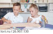 Купить «Girl and boy are satisfied of play in board game at home.», видеоролик № 26907130, снято 11 августа 2017 г. (c) Яков Филимонов / Фотобанк Лори