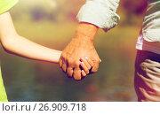 senior man and child holding hands. Стоковое фото, фотограф Syda Productions / Фотобанк Лори