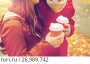 Купить «close up of happy couple with coffee in autumn», фото № 26909742, снято 9 октября 2016 г. (c) Syda Productions / Фотобанк Лори