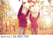 Купить «happy young couple throwing autumn leaves in park», фото № 26909754, снято 9 октября 2016 г. (c) Syda Productions / Фотобанк Лори