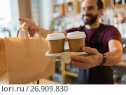 Купить «man or bartender serving customer at coffee shop», фото № 26909830, снято 8 декабря 2016 г. (c) Syda Productions / Фотобанк Лори