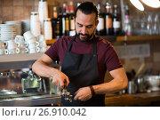 Купить «barista man making espresso at bar or coffee shop», фото № 26910042, снято 8 декабря 2016 г. (c) Syda Productions / Фотобанк Лори