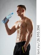 Купить «young man or bodybuilder with bottle of water», фото № 26910394, снято 2 июля 2017 г. (c) Syda Productions / Фотобанк Лори