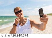Купить «man with smartphone taking selfie on summer beach», фото № 26910574, снято 27 июля 2017 г. (c) Syda Productions / Фотобанк Лори
