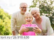 Купить «senior grandparents and granddaughter selfie», фото № 26910630, снято 9 августа 2017 г. (c) Syda Productions / Фотобанк Лори
