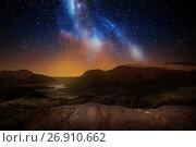 Купить «mountain landscape over night sky or space», фото № 26910662, снято 25 июня 2016 г. (c) Syda Productions / Фотобанк Лори