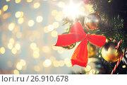 Купить «close up of red bow decoration on christmas tree», фото № 26910678, снято 7 октября 2015 г. (c) Syda Productions / Фотобанк Лори