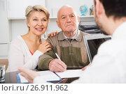 Купить «Old man and woman in social department», фото № 26911962, снято 18 января 2019 г. (c) Яков Филимонов / Фотобанк Лори